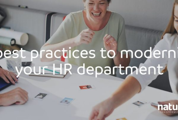A group of employees are strategically planning how to modernise HR activities