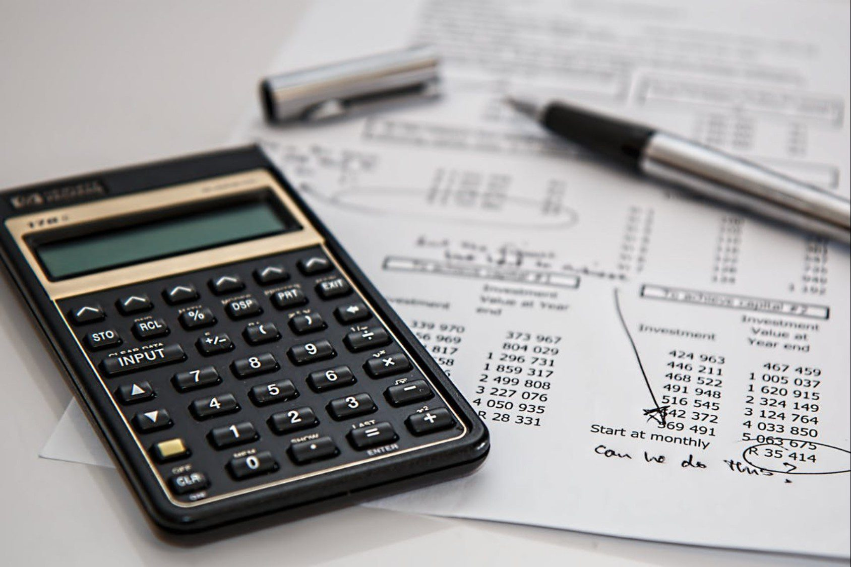 HR and Finance using a calculator to work out the company's finance