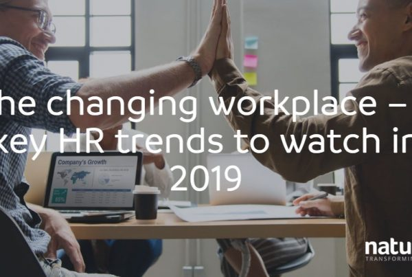 Two male colleagues preparing for the top HR trends 2019