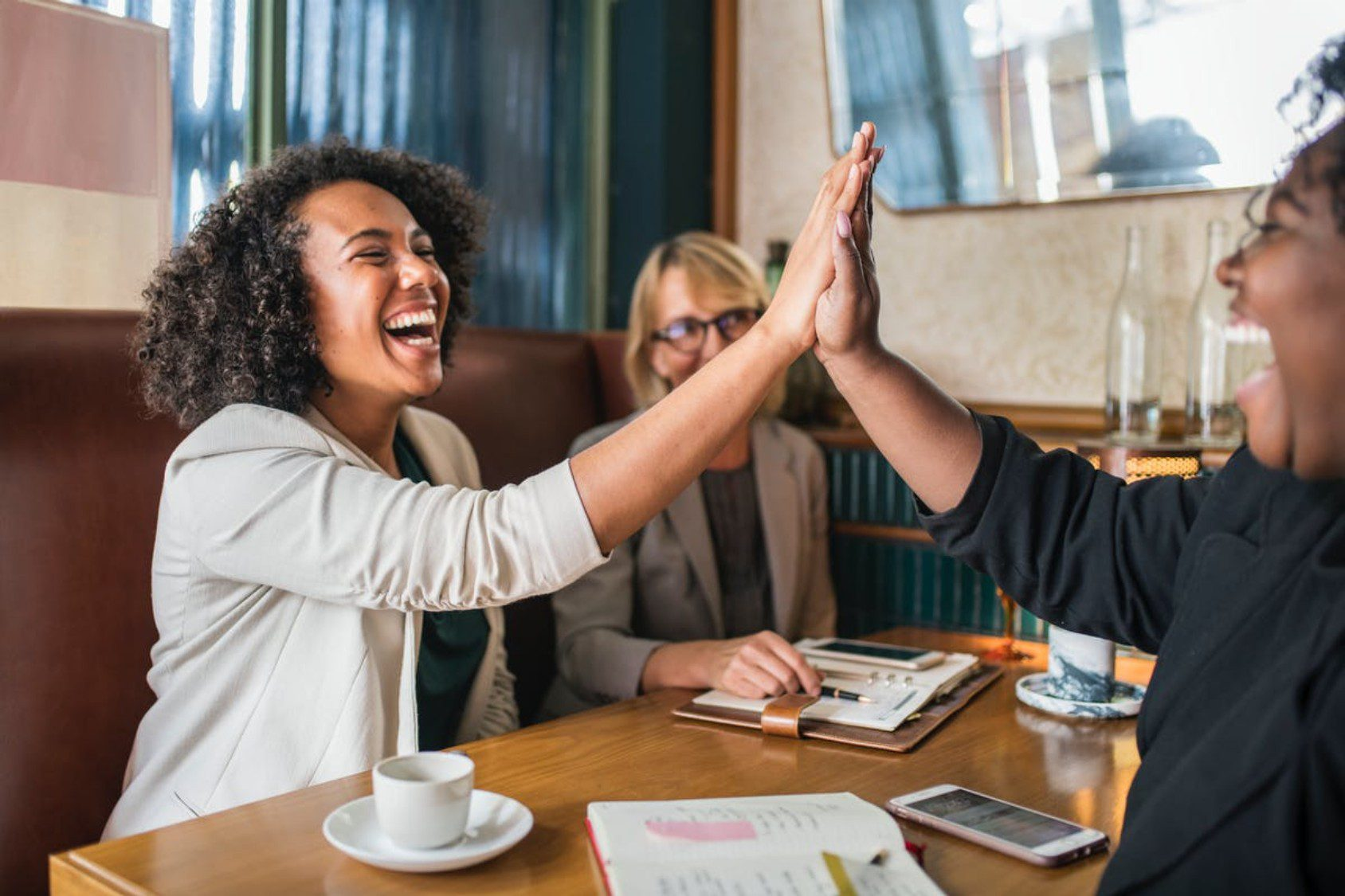HR leaders happily communicate within their meeting